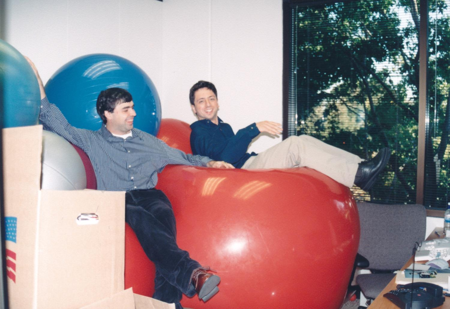 Larry and Sergey relaxing on beanbags after a party